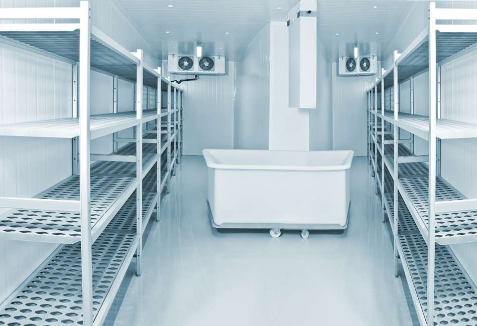 Refrigeration chamber for food storage. Installation for the production of ice. Refrigeration equipment for production. Freezing room with shelves.